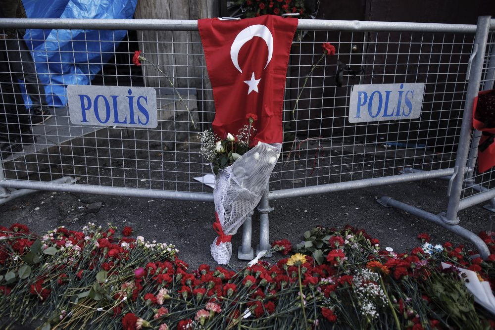 Carnations lay on the ground, near the scene, a day after an attack at a popular nightclub in Istanbul, Monday, Jan. 2, 2017. Turkey's state-run news agency says police have detained eight people in connection with the Istanbul nightclub attack. The gunman, who escaped after carrying out the attack, wasn't among the eight. The Islamic State group has claimed responsibility for the attack, which killed 39 people, most of them foreigners. (Halit Onur Sandal/AP)