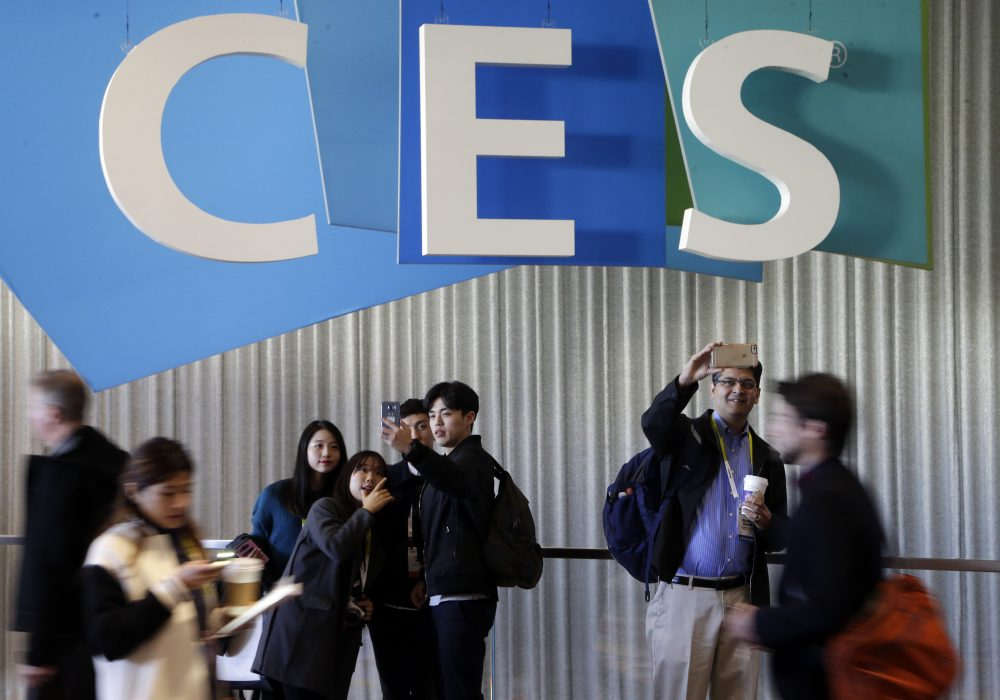 People take pictures in the halls at CES International, Thursday, Jan. 7, 2016, in Las Vegas. (Gregory Bull/AP)