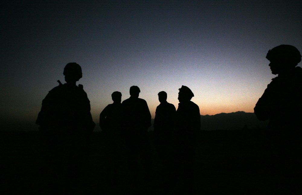 U.S. Army soldiers stand with Afghan policemen before a joint patrol of Qalanderkhail, outside of Bagram Air Field in Afghanistan in October 2009. (Maya Alleruzzo/AP)
