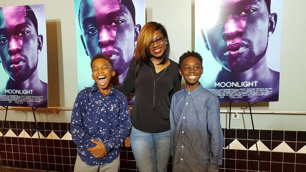 Tanisha Cidel, drama teacher at Norland Middle, with her students Jaden Piner (left) and Alex Hibbert (right) who star in the movie Moonlight. (Courtesy Natalie Piner via WLRN)