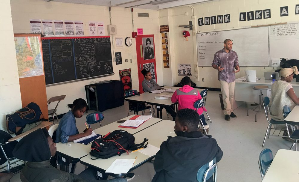 Darrell Anane, a first-year teacher at Madison Park Technical Vocational High School, leads a discussion on Prohibition with his 10th-grade U.S. history students.  (Tonya Mosley/WBUR)