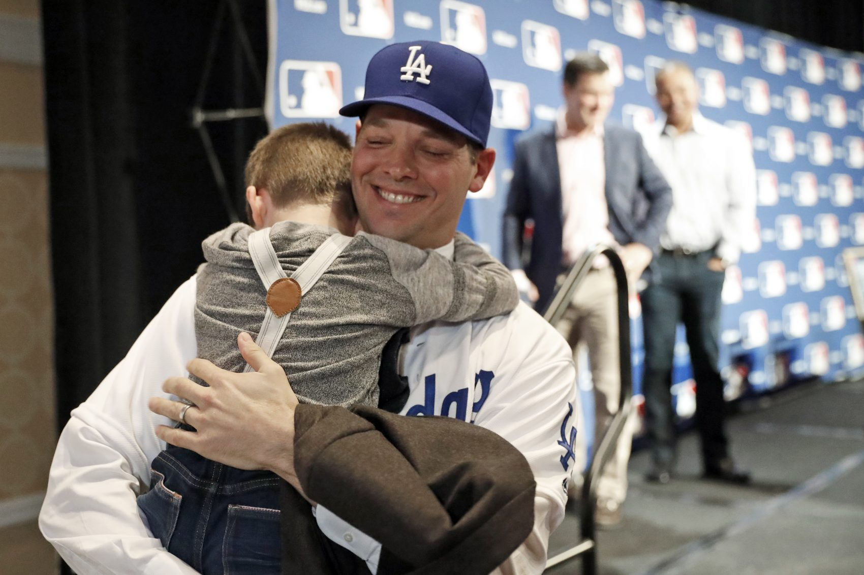 Los Angeles Dodgers pitcher Rich Hill hugs his son Brice Hill after signing a 3-year, $48 million contract on Dec. 5. (Alex Brandon/AP)