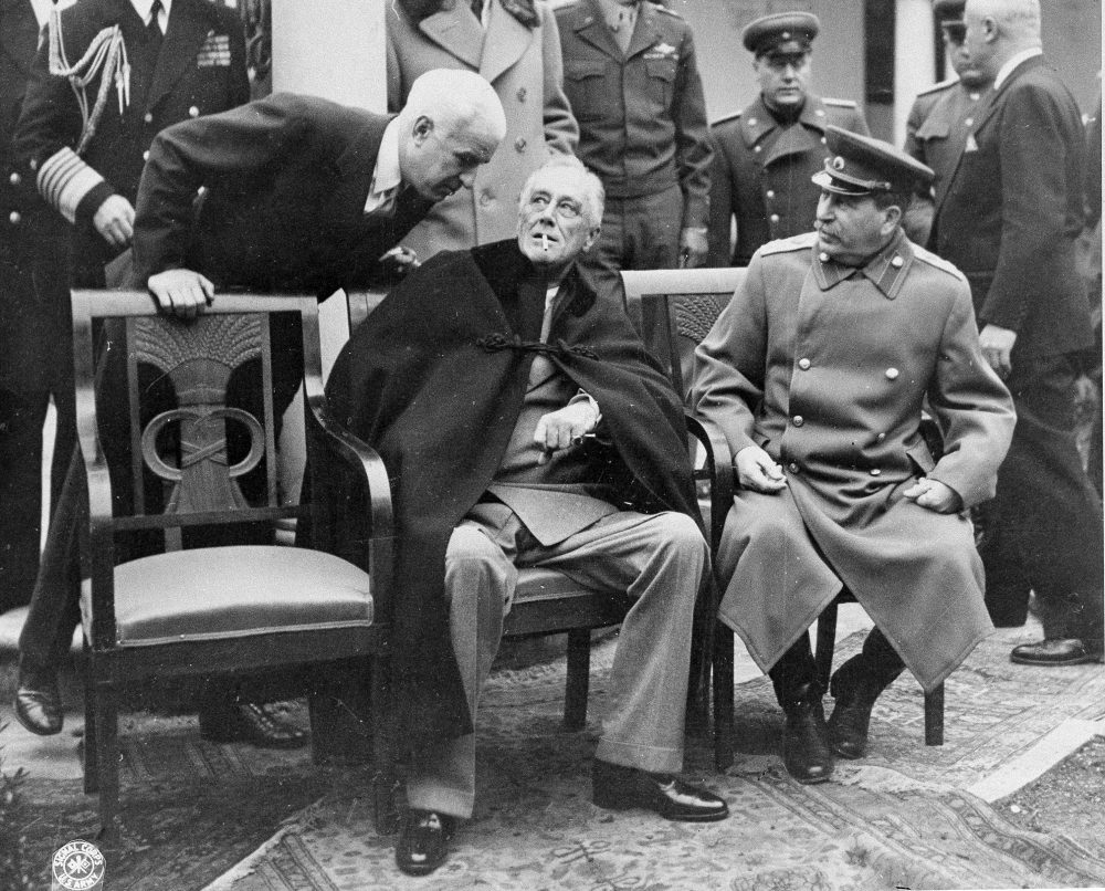 President Franklin D. Roosevelt, center, and Marshal Josef Stalin, right, at the Yalta Conference in Yalta, Crimea, on Feb. 16, 1945. (British Official Photo/AP)
