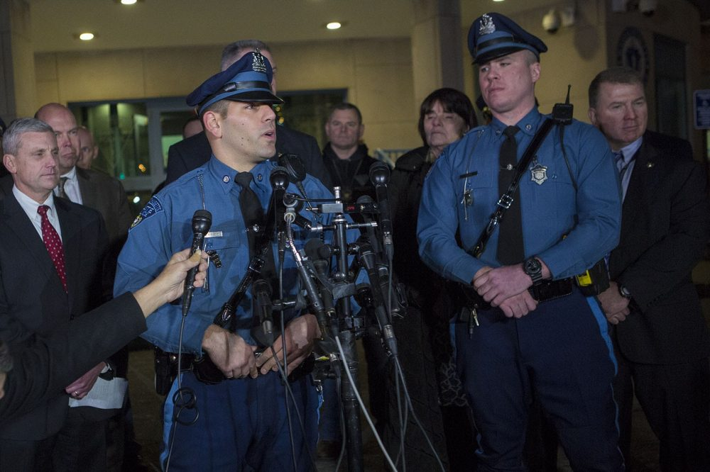Massachusetts State Troopers Joseph Merrick, left, and Brendan Cain apprehended wanted fugitive James Morales on Wheatland Street in Somerville following what police say were two attempts by Morales to rob banks in the area. (Jesse Costa/WBUR)