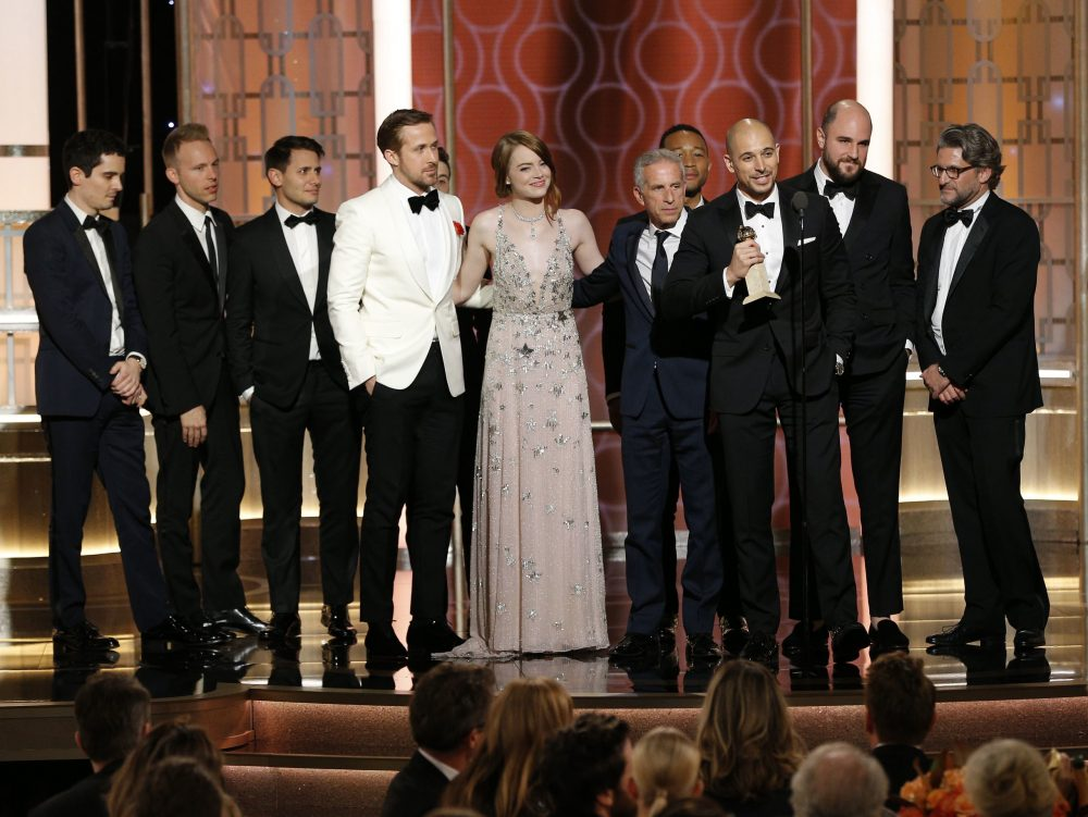 "The cast and crew of ""La La Land"" accepting the award for best motion picture (musical or comedy) at the 74th Annual Golden Globe Awards on Sunday, Jan. 8, 2017. (Paul Drinkwater/NBC via AP)"