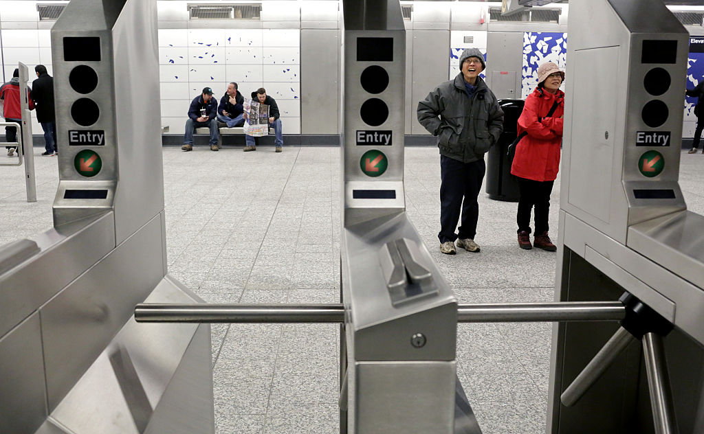 Commuters look at art by Sarah Sze at the 96th St. Q train station on the newly opened Second Avenue subway line on Jan. 1, 2017 in New York. (Yana Paskova/Getty Images)