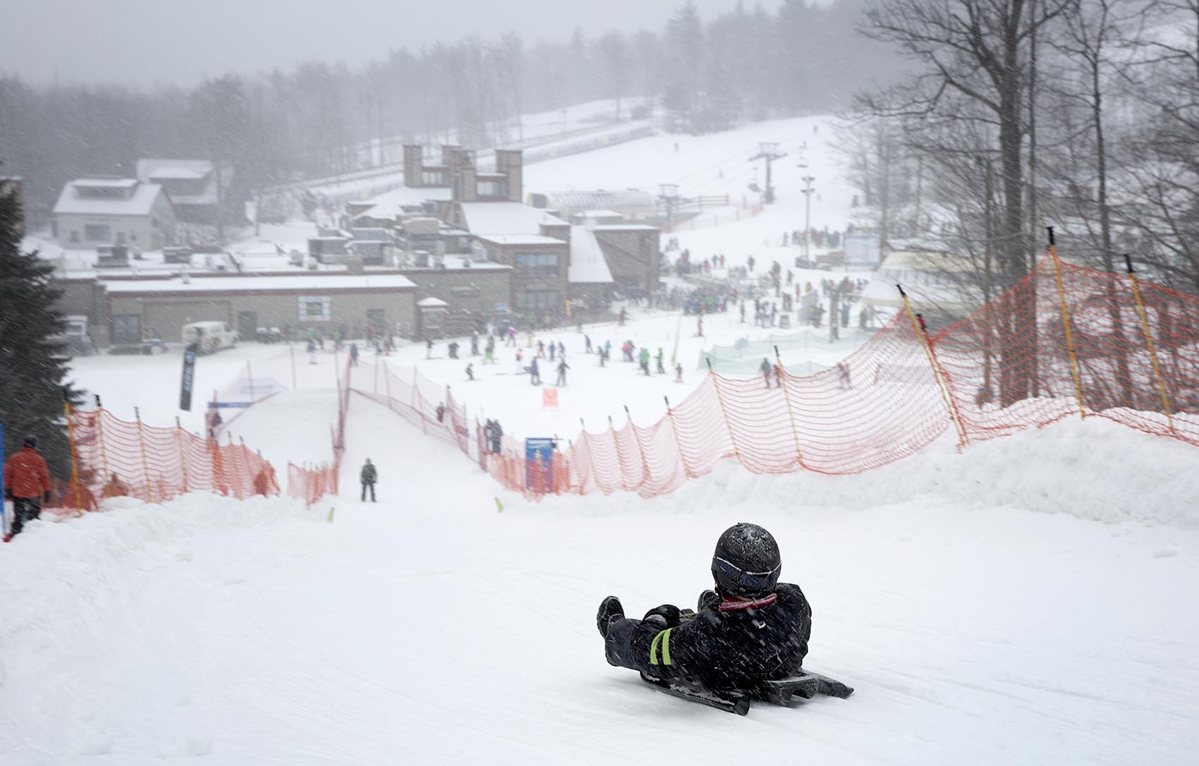 A young luger sets off down the slope at a USA Luge event at Wachusett Mountain. (Robin Lubbock/WBUR)