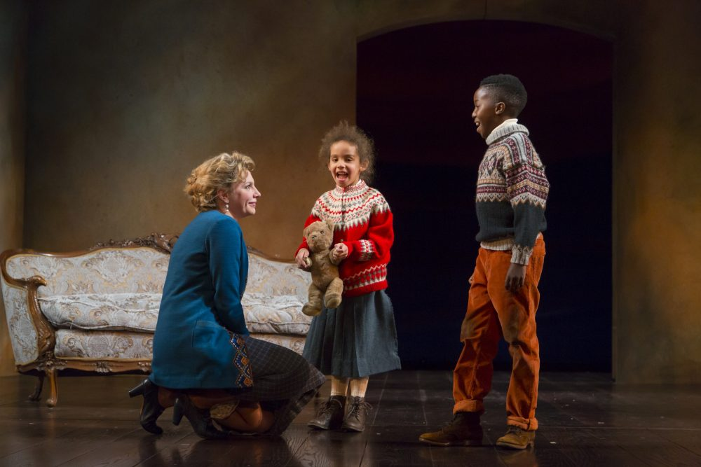 "Nora Helmer (played by Andrea Syglowski) with her children in ""A Doll's House."" (Courtesy T. Charles Erikson/Huntington Theatre Company)"
