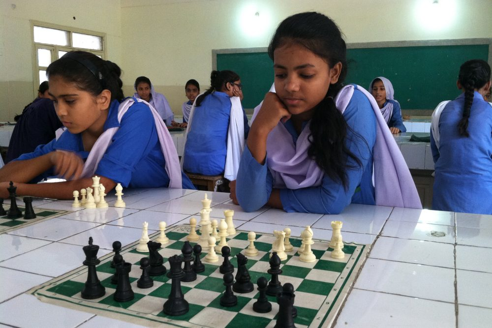 Girls study and compete in chess, just one of several extracurricular activities added to this girls' public school since the Zindagi Trust adopted it in 2007. (Laura Isensee/Houston Public Media)