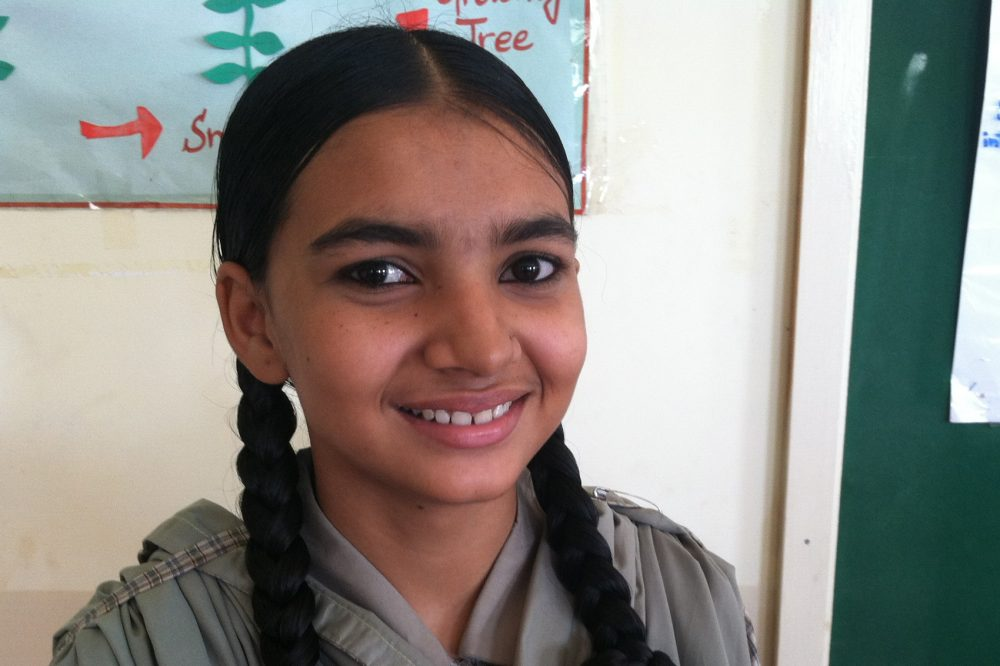 Rizwana Ruab, 16, attends the ninth grade at one of the schools with Developments in Literacy in Orangi. She is studying biology so she can become a police officer. She spends several hours every day making shoes with her family. She earns on average about 20 U.S. cents an hour. (Laura Isensee/Houston Public Media)