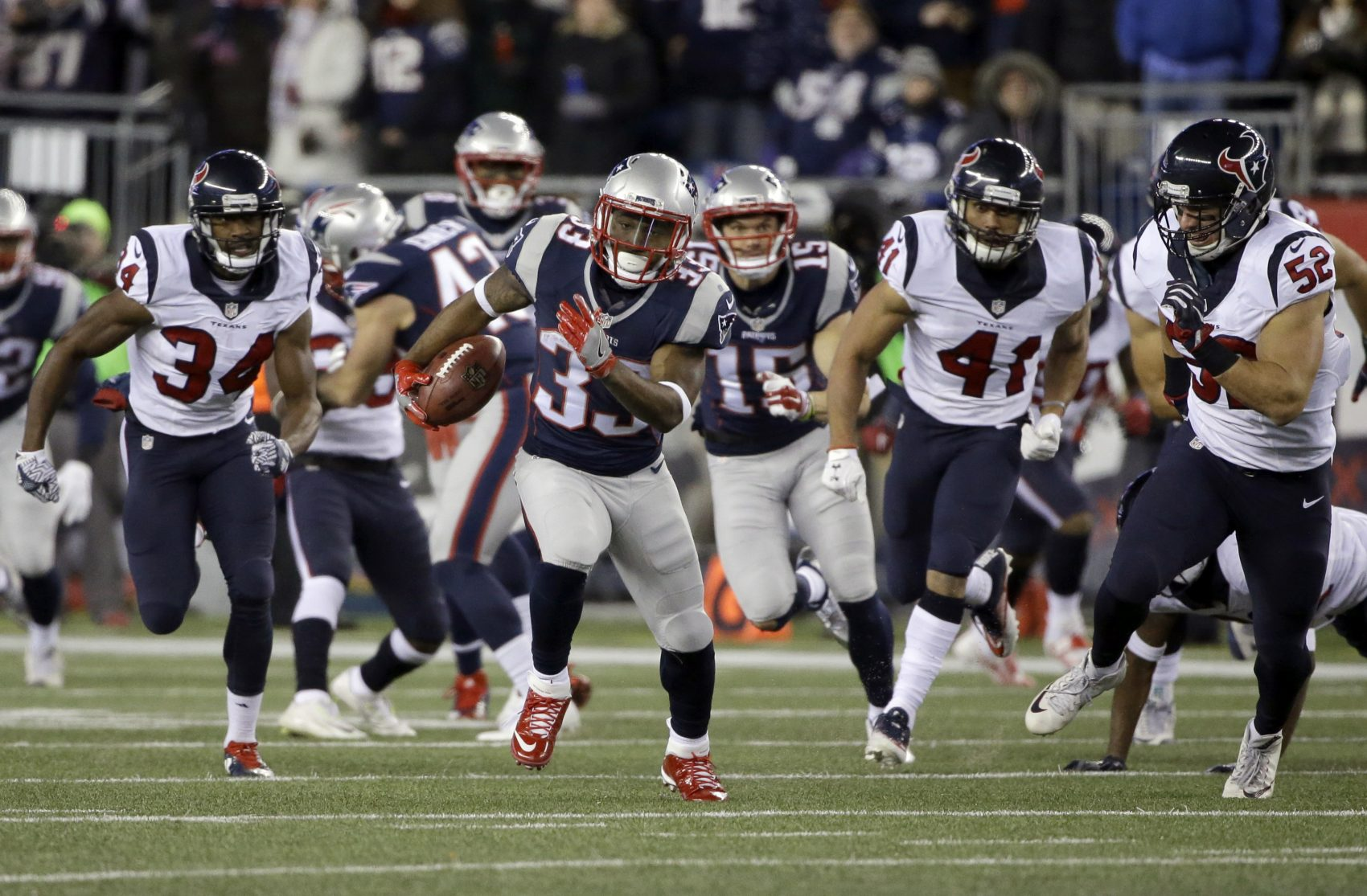 New England Patriots running back Dion Lewis runs for a touchdown against the Houston Texans during the first half of Saturday's AFC divisional playoff game at Gillette Stadium. (Elise Amendola/AP)