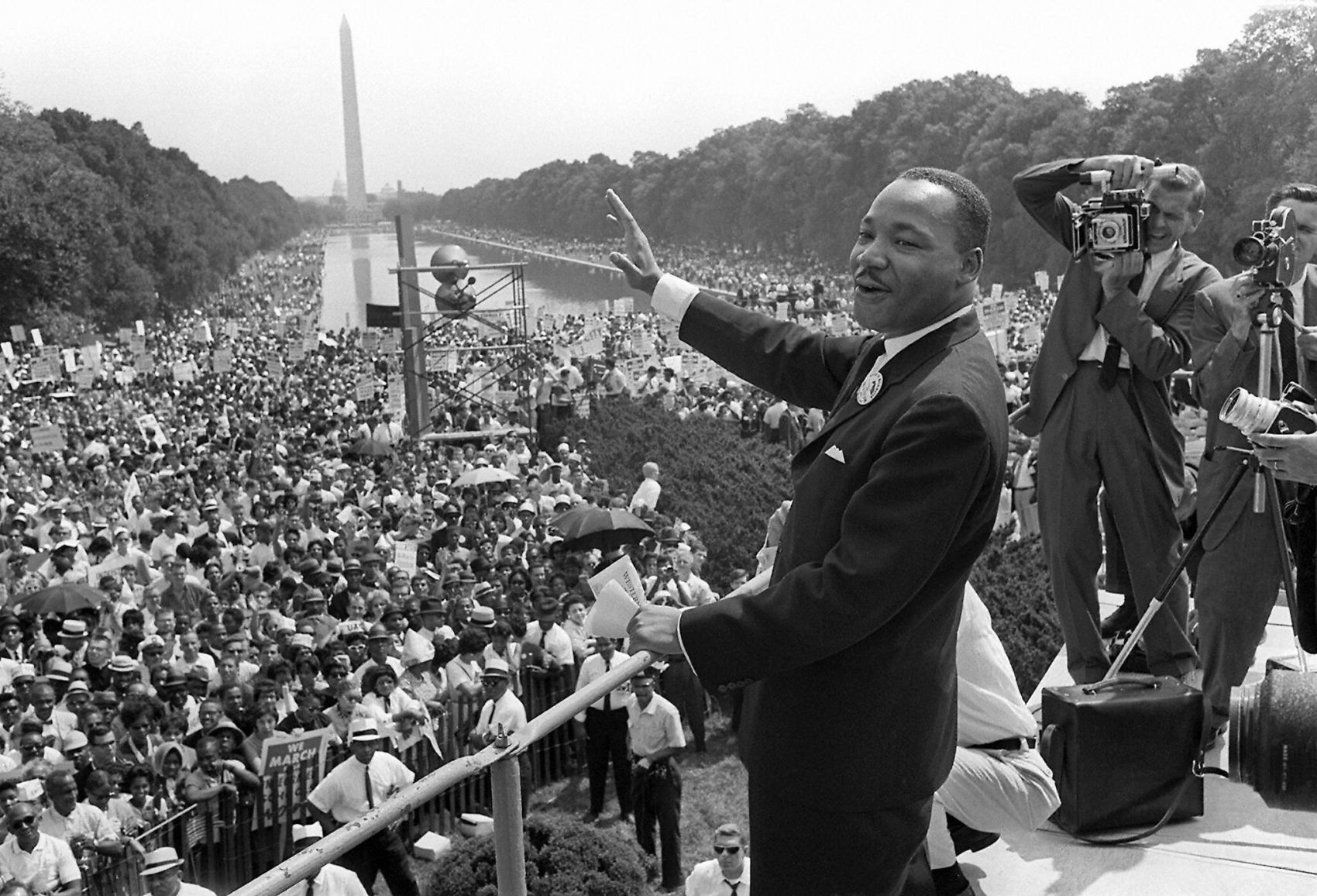 "Martin Luther King Jr. waves to supporters from the steps of the Lincoln Memorial in Washington, D.C., during the March on Washington where King delivered his famous ""I Have a Dream"" speech on Aug. 28, 1963. (AFP/Getty Images)"