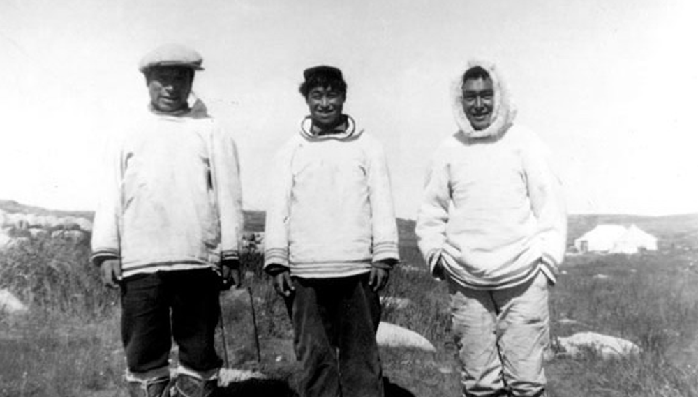 Three Inuit men. Peter Sala, (left), the best hunter and ice navigator, was considered God on the island. (Courtesy Avataq Cultural Institute)