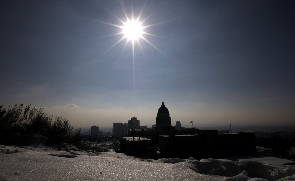 The silhouette of Utah State Capitol is shown against the blue sky and particulates from an inversion Wednesday, Jan. 2, 2013, in Salt Lake City. (Rick Bowmer/AP)