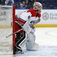 On Dec. 31, 2016, Carolina Hurricanes equipment manager Jorge Alves signed a one-day, $500 contract that brought his dream to life. (Mike Carlson/AP)