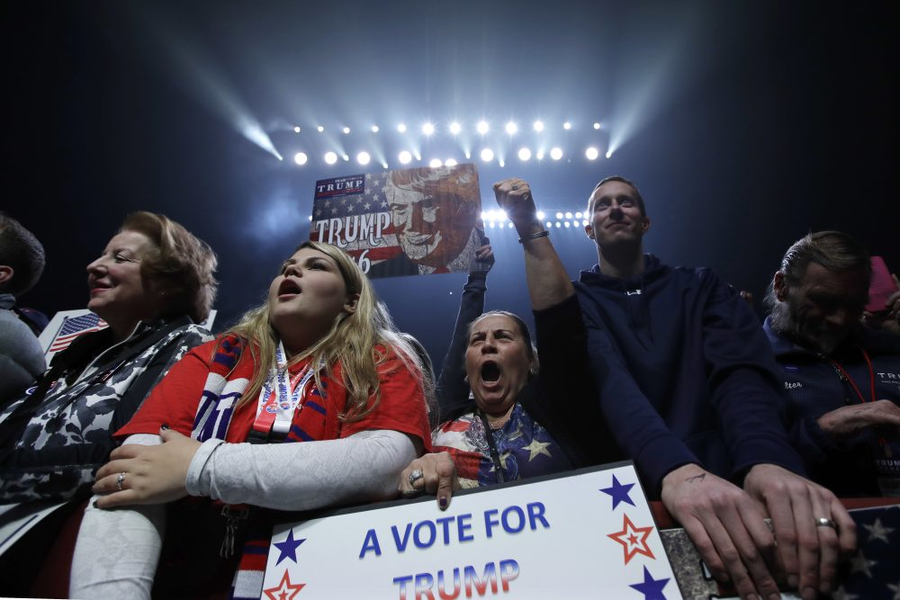 Trump supporters cheer at a rally the day before the election in Manchester, N.H. (Charles Krupa/AP)