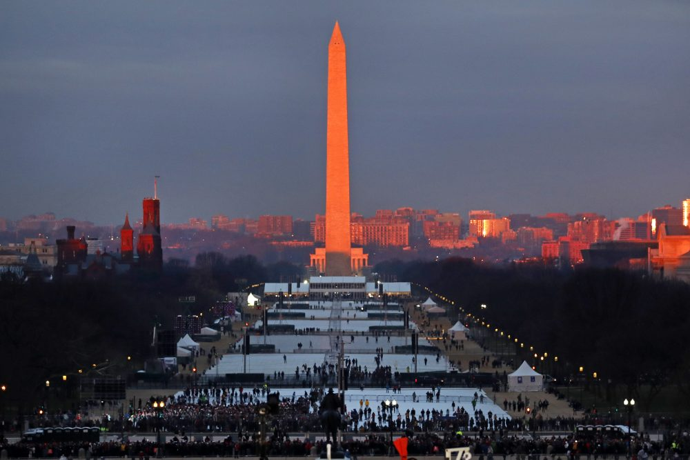 The crowd starts to fill the National Mall as the sun rises before the swearing in of Donald Trump as the 45th President of the Untied State during the 58th Presidential Inauguration at the U.S. Capitol in Washington, Friday. (Carolyn Kaster/AP)