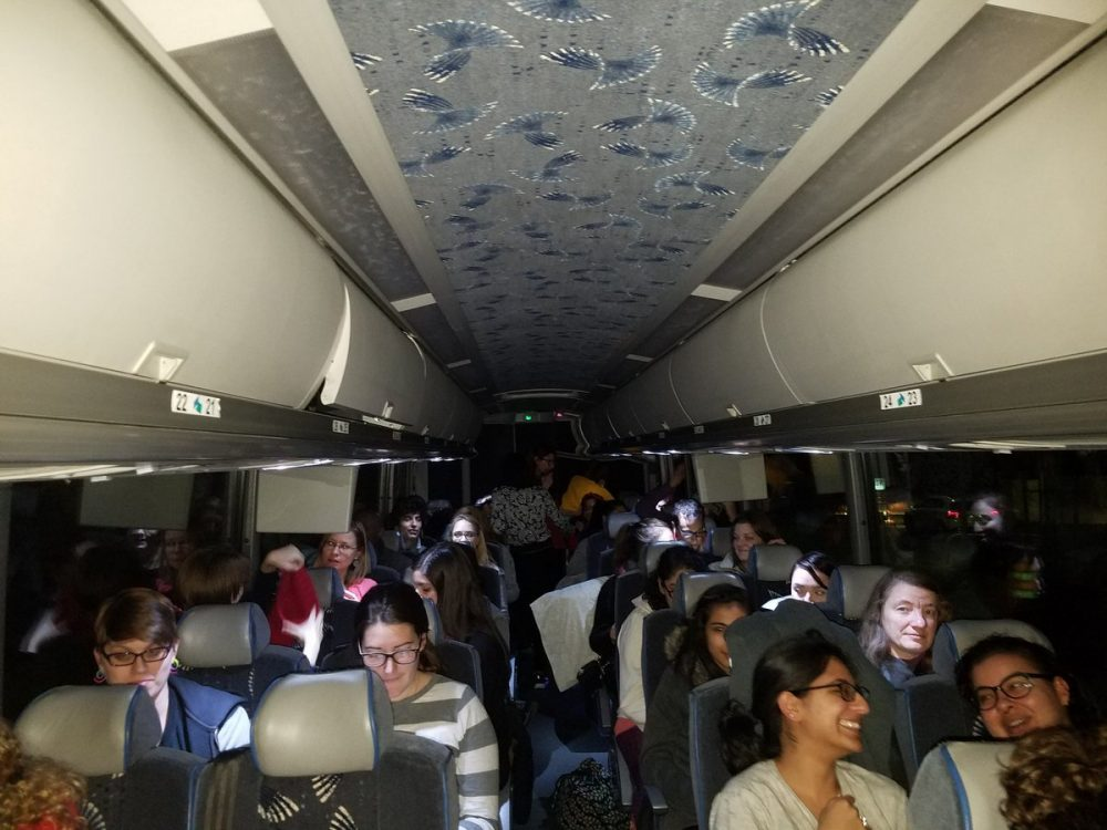 More than 50 people -- mostly women and Harvard graduate students -- drove through the night on a chartered bus from Cambridge to D.C. for Saturday's Women's March  on Washington. (Zeninjor Enwemeka/WBUR)