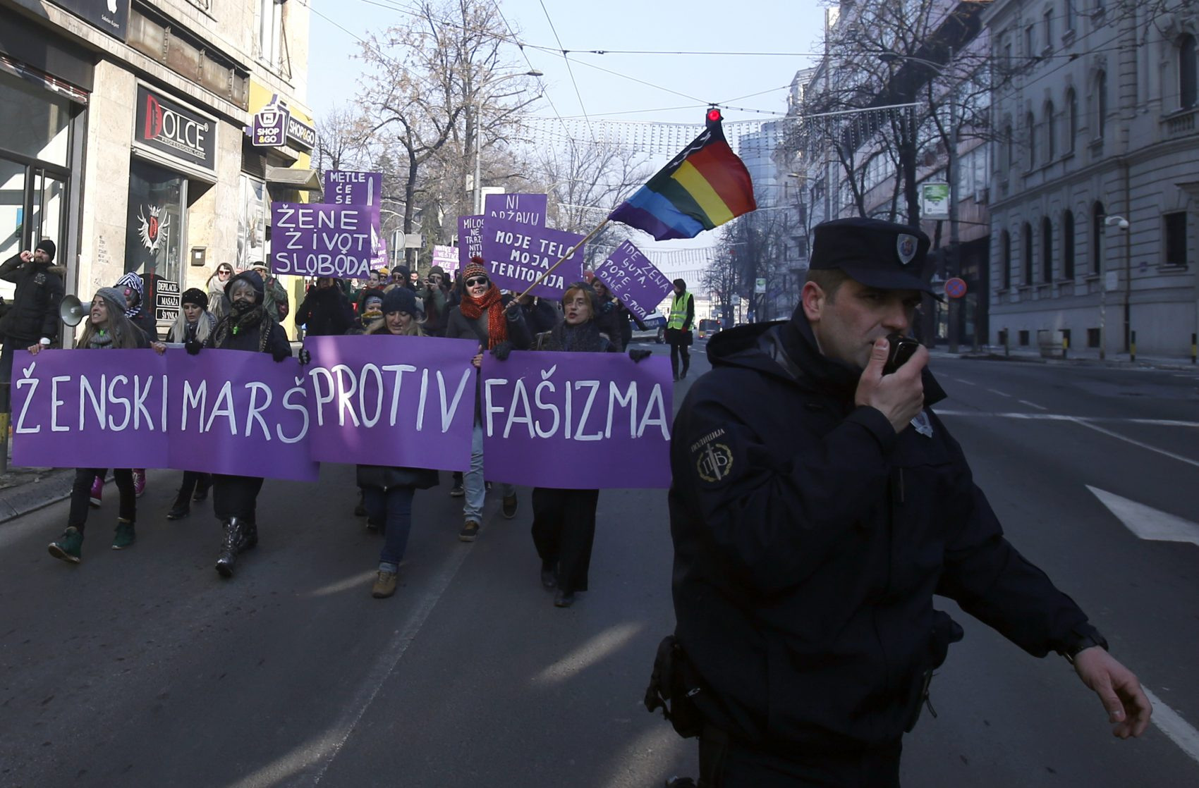 "Activists hold a banner that read, ""Women's March against Fascism"" during the Women's March rally in Belgrade, Serbia. (Darko Vojinovic/AP)"