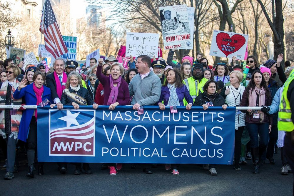 State Attorney General Maura Healey, Sen. Ed Markey, philanthropist Barbara Lee, Sen. Elizabeth Warren, Mayor Marty Walsh and State Treasurer Deb Goldberg march down Commonwealth Avenue for the Women's March for America in Boston. (Jesse Costa/WBUR)