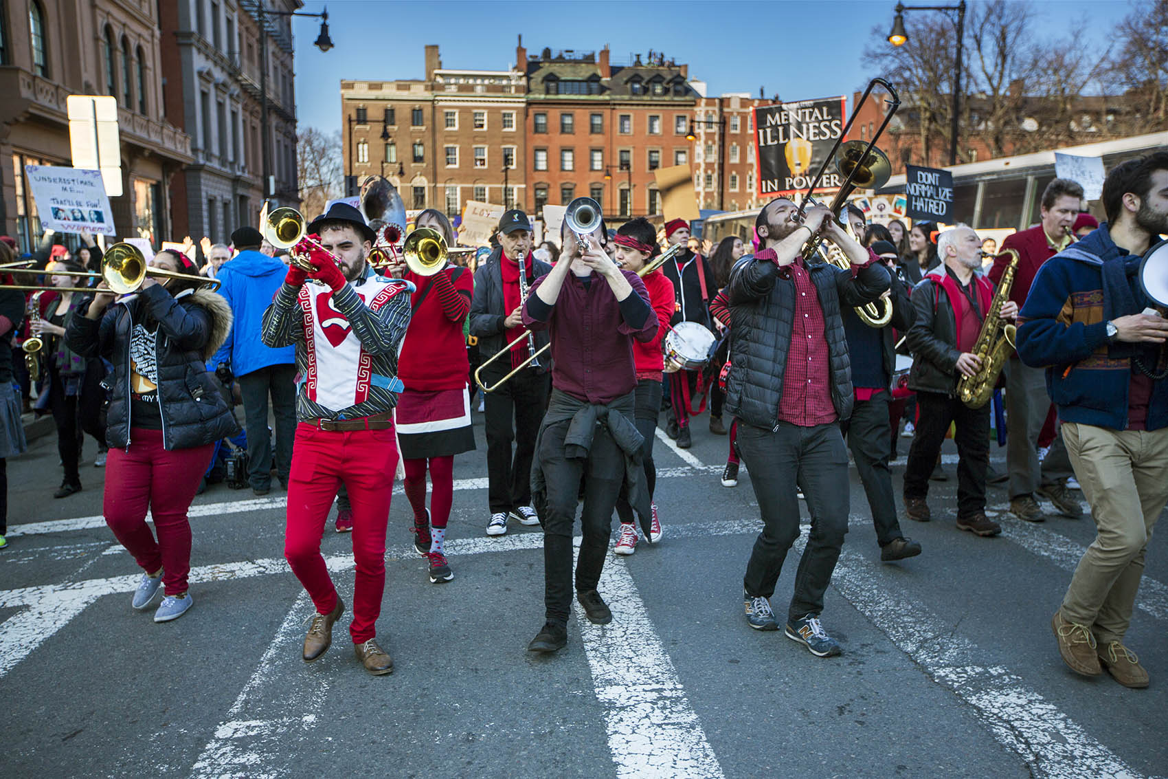 Somerville's Second Line Social Aid and Pleasure Society Brass Band plays while marching down Arlington Street in Boston during the Women's March for America on Saturday. (Jesse Costa/WBUR)