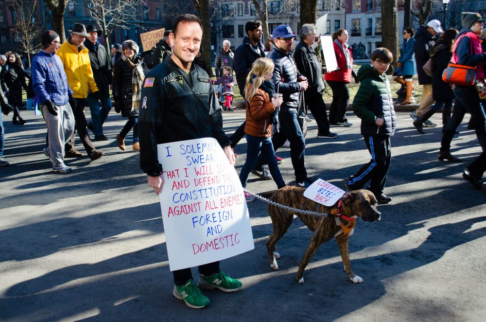 Dan Futrell and his dog, Liberty, were a crowd favorite on the march down Commonwealth Avenue. (Elizabeth Gillis/WBUR)