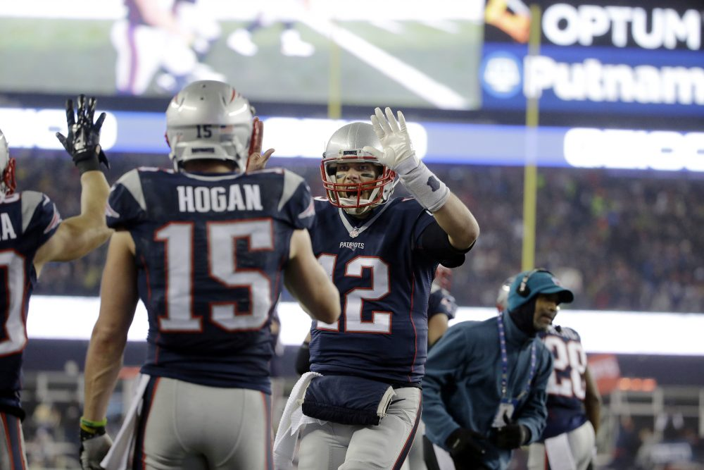 New England Patriots quarterback Tom Brady (12) celebrates with wide receiver Chris Hogan (15) after a touchdown pass during the first half of the AFC championship NFL football game against the Pittsburgh Steelers on Sunday in Foxborough, Mass. (Elise Amendola/AP)