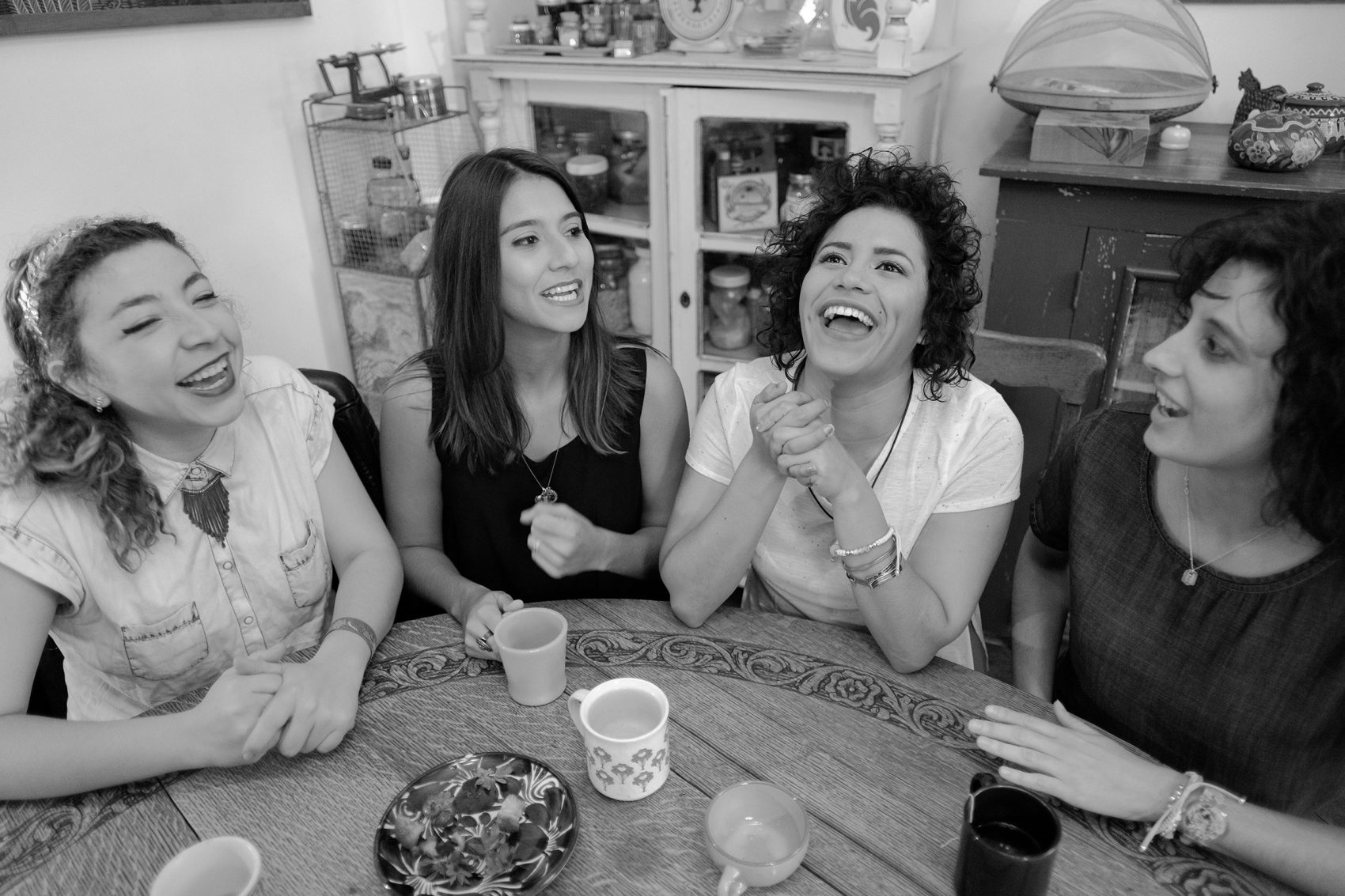 The members of LADAMA sit around a kitchen table in New York City. (Courtesy Kevin Bay)