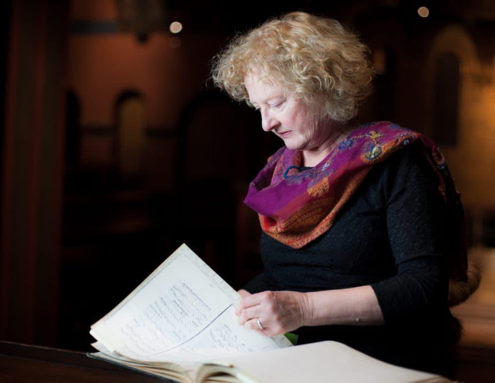 "Boston Camerata's artistic director Anne Azéma pores over a manuscript of ""Play of Daniel."" (Courtesy Kristin Otharsson)"