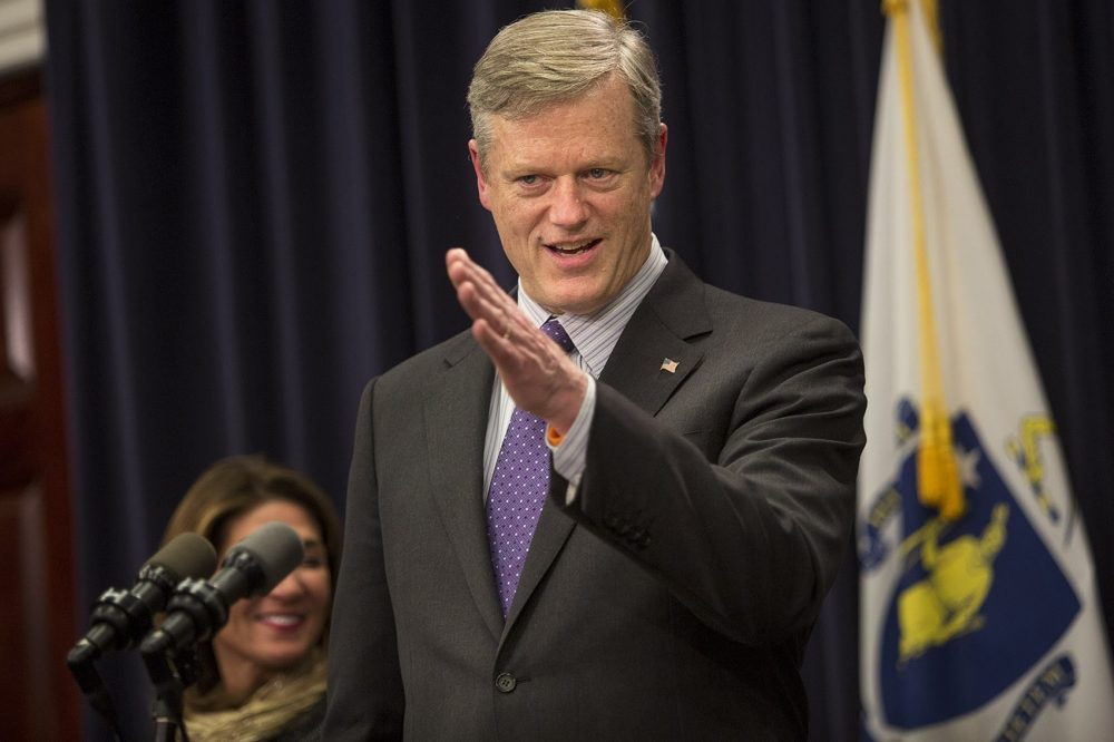 Gov. Charlie Baker fields questions from the media after announcing his budget proposal on Wednesday. (Jesse Costa/WBUR)