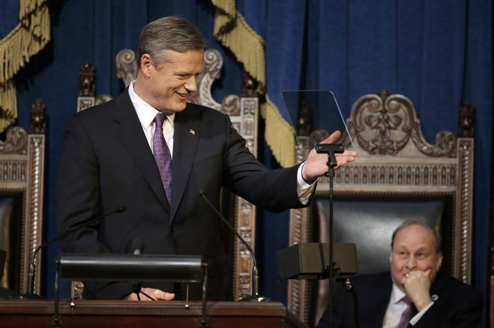 Gov. Charlie Baker, left, addresses a joint session of the state Legislature during his State of the State address as Mass. Senate President Stan Rosenberg, right, looks on in the House chamber at the Statehouse Tuesday. (Steven Senne/AP)