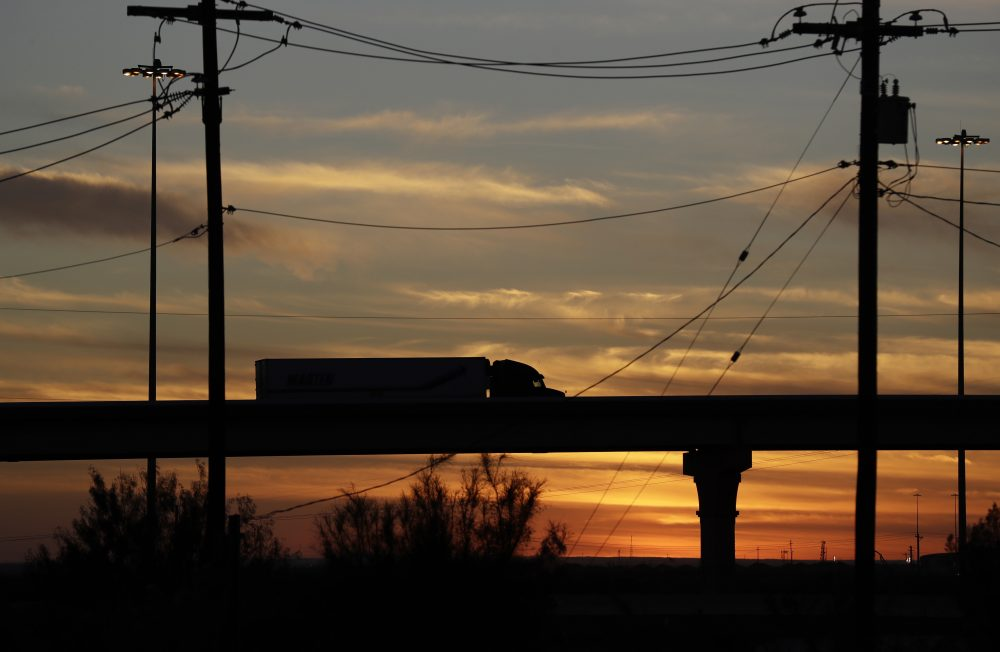 In this Monday, Nov. 21, 2016 photo, a truck travels on an overpass towards the World Trade Bridge, in Laredo, Texas. Donald Trump's campaign promise to abandon the North American Free Trade Agreement is unnerving to many people in cities on the U.S.-Mexico border. Communities such as Laredo and El Paso in Texas or Nogales in Arizona have boomed under the 1994 treaty. (Eric Gay/AP)