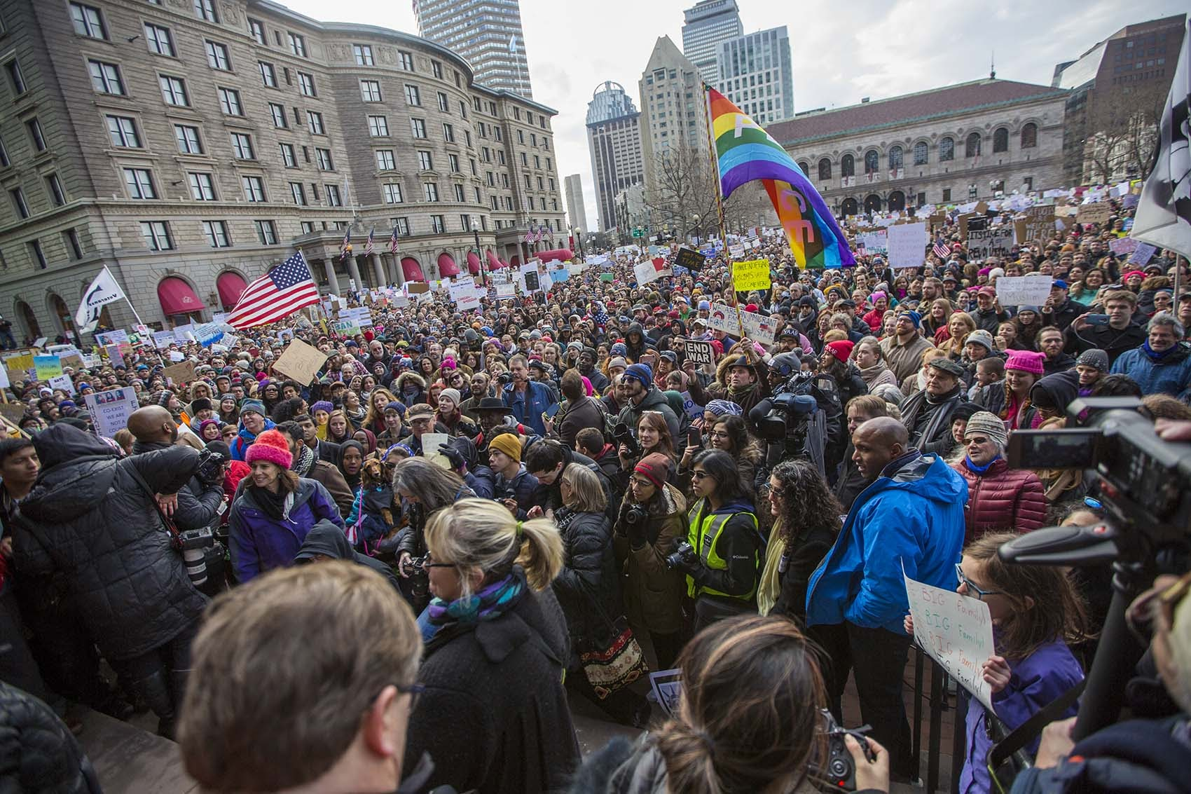 Copley Square was jammed with people during the Sunday's protest in opposition to President Trump's executive order on immigration. Carlos Arredondo stood among the crowd, holding a rainbow peace flag. (Jesse Costa/WBUR)