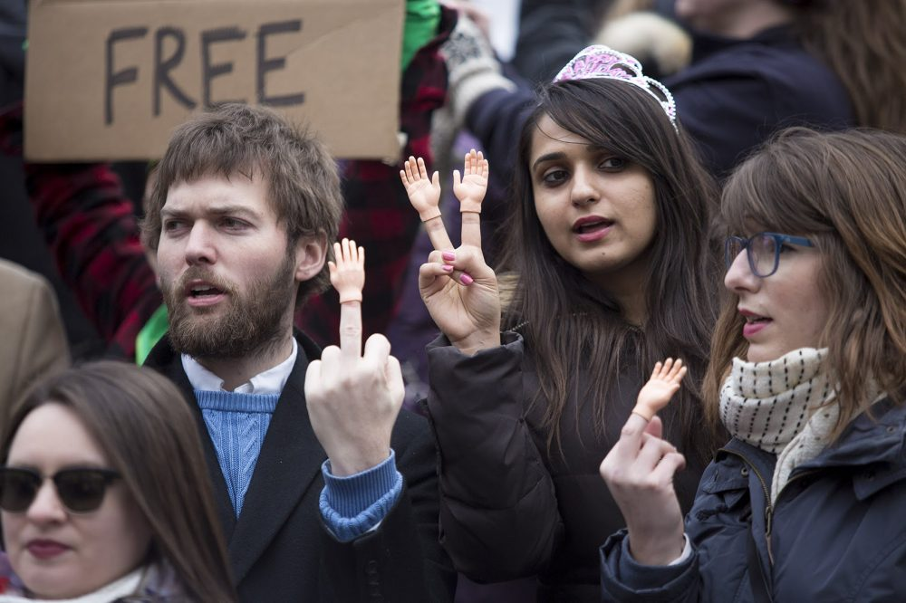 Protesters came to Copley Square with tiny hands on their fingers. (Jesse Costa/WBUR)