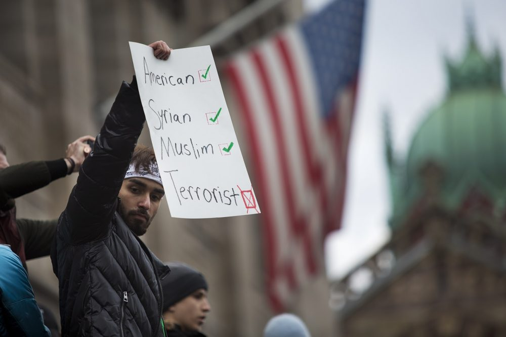 A protester in front of the Boston Public Library in Copley Square Sunday. (Jesse Costa/WBUR)