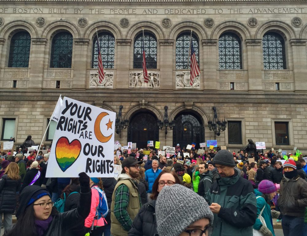 Protesters gathered on the steps of the Boston Public Library ahead of the rally. (Amy Gorel/WBUR)