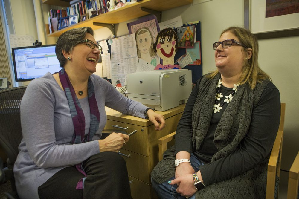 Dr. Vicki Jackson, left, the chief of palliative care at MGH, speaks with Lisa Geller. Immunotherapy helped rid Geller of her cancer. But because the long-term prognosis with these new medications is still not clear, even after going into remission patients can be on an emotional roller coaster. (Jesse Costa/WBUR)