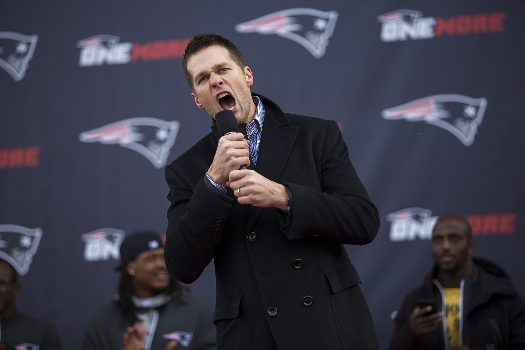 Tom Brady pumps up the crowd during the Patriots' Super Bowl sendoff in Foxborough. (Jesse Costa/WBUR)