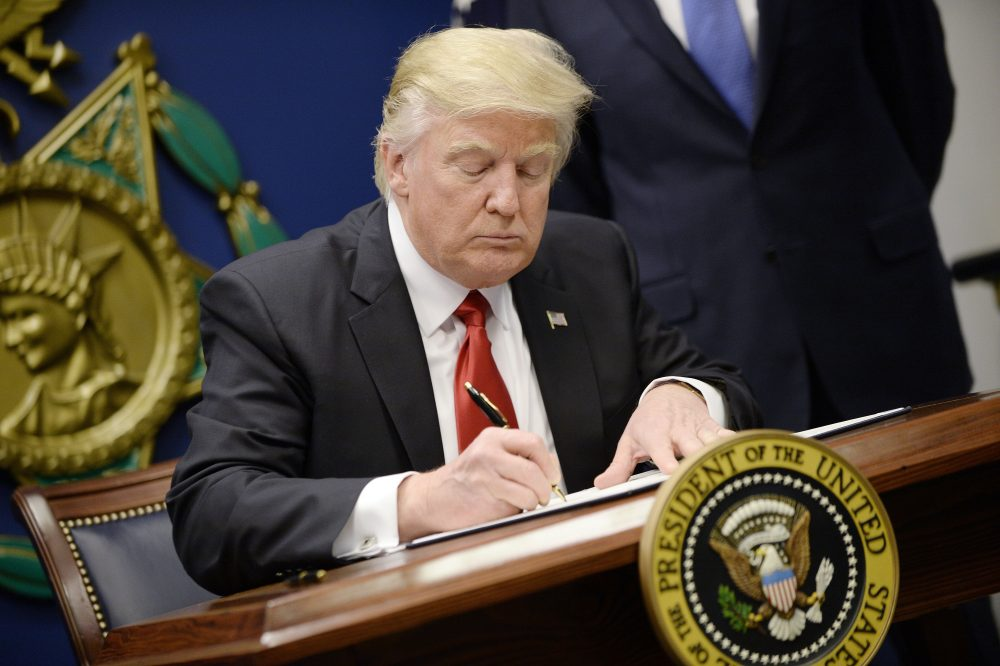 "President Donald Trump signs executive orders in the Hall of Heroes at the Department of Defense on Jan. 27, 2017 in Arlington, Va. Trump signed two orders calling for the ""great rebuilding"" of the nation's military and the ""extreme vetting"" of visa seekers from seven countries with predominately Muslim populations. (Olivier Douliery-Pool/Getty Images)"