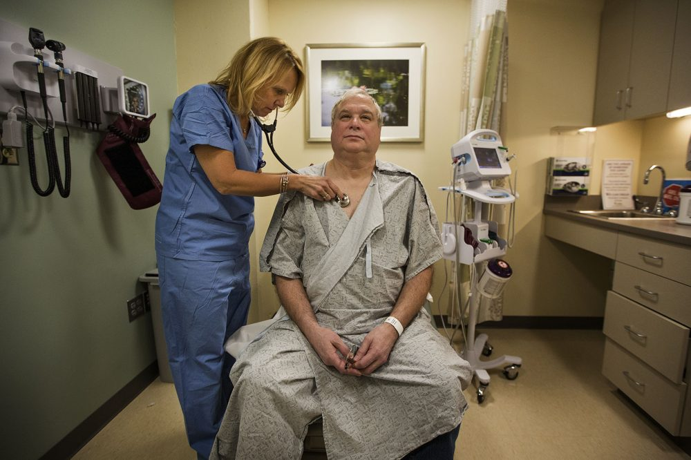 Ron Dombrowski is examined by nurse practitioner Pamela Park at the Wiener Center for Preoperative Evaluation at Brigham and Women's Faulkner Hospital. (Jesse Costa/WBUR)