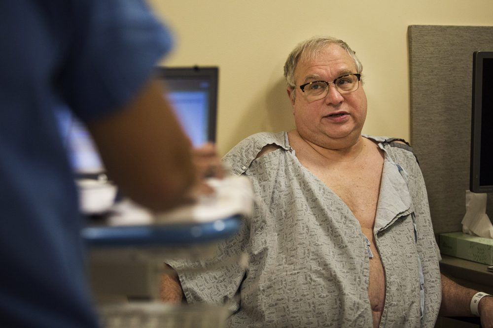 Ron Dombrowski answers questions during a pre-op appointment. (Jesse Costa/WBUR)