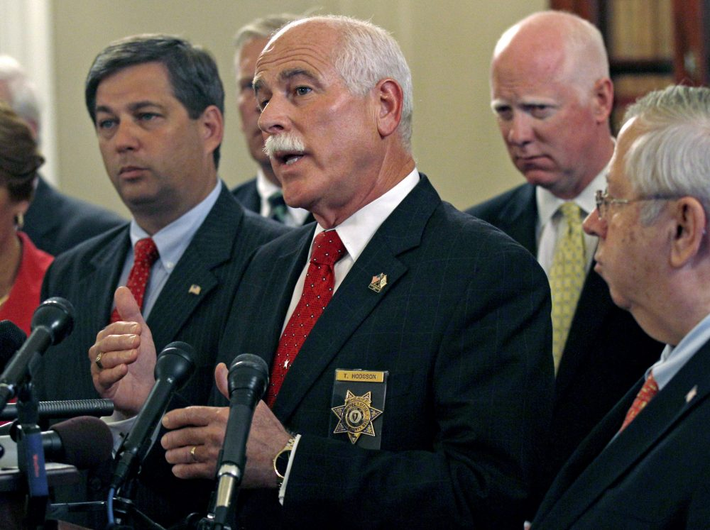 Bristol County Sheriff Thomas Hodgson gestures during a news conference at the State House in Boston in 2011. (Charles Krupa/AP)
