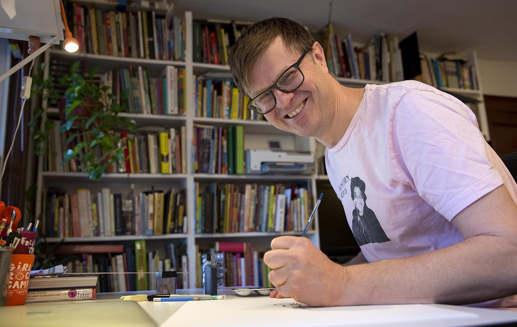 Children's book author Jef Czekaj at his studio in Somerville. (Robin Lubbock/WBUR)