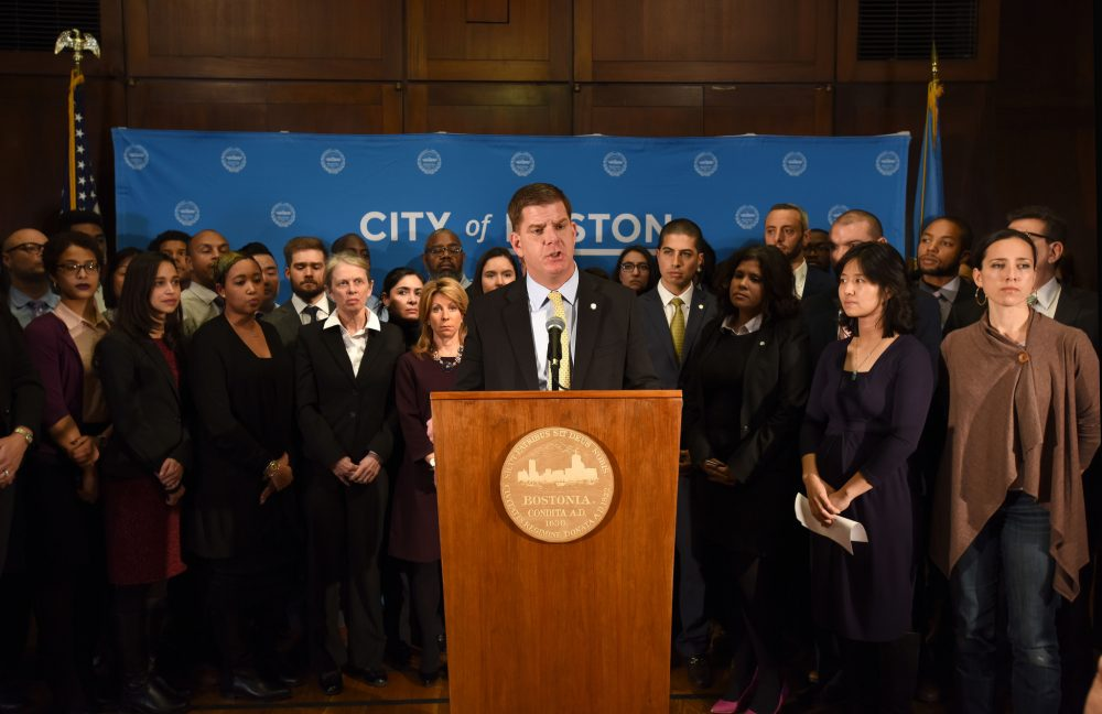 Surrounded by members of his administration and state lawmakers, Mayor Marty Walsh speaks about President Trump's immigration executive orders. (Courtesy of Isabel Leon/Mayor's Office)