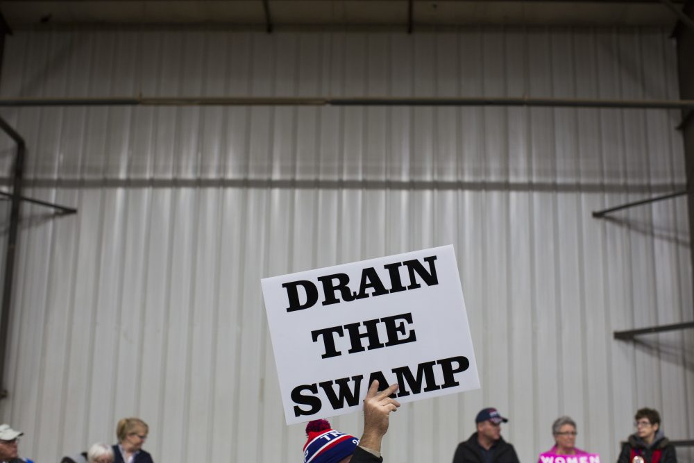 In this Oct. 27, 2016, file photo, supporters of then-Republican presidential candidate Donald Trump hold signs during a campaign rally in Springfield, Ohio. (Evan Vucci/AP)