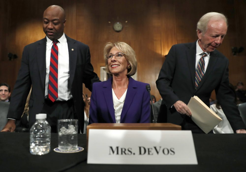 Education Secretary-designate Betsy DeVos arrives with former Sen. Joe Lieberman, right, and Sen. Tim Scott, R-S.C., before testifying on Capitol Hill in Washington, Tuesday, Jan. 17, 2017, at her confirmation hearing before the Senate Health, Education, Labor and Pensions Committee. (AP Photo/Carolyn Kaster)