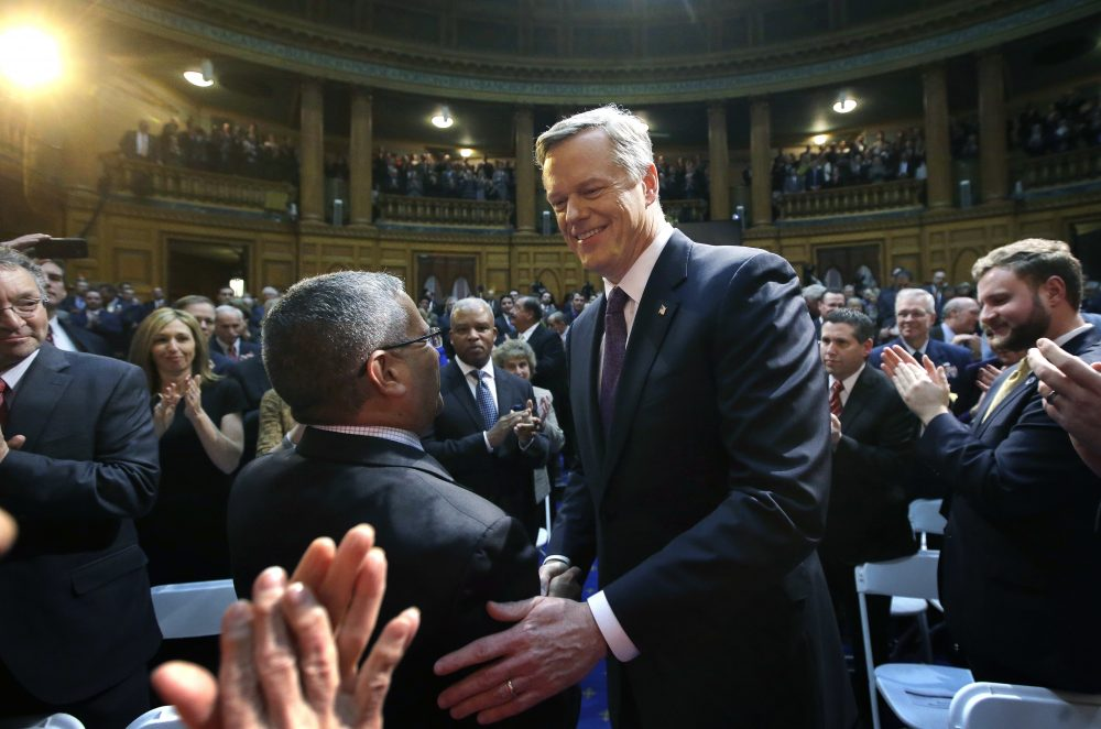 Massachusetts Republican Gov. Charlie Baker, center, greets law makers and guests as he enters the House chamber at the Statehouse before his State of the State address, Tuesday, Jan. 24, 2017, in Boston. (AP Photo/Steven Senne)