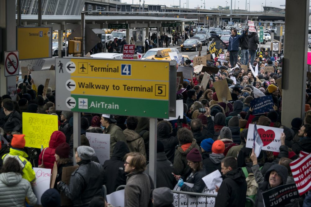 The most powerful denunciation, heard by writer Rich Barlow, of President Trump's refugee ban is 2,000 years old: St. Paul and Matthew's gospel. Protesters assemble at John F. Kennedy International Airport in New York, Saturday, Jan. 28, 2017 after two Iraqi refugees were detained while trying to enter the country. On Friday, Jan. 27, President Donald Trump signed an executive order suspending all immigration from seven countries with terrorism concerns for 90 days. (Craig Ruttle/AP)