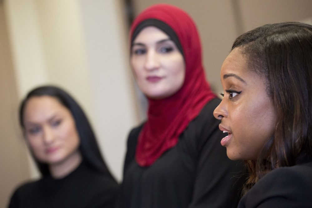 Tamika Mallory, right, co-chair of the Women's March on Washington, talks during an interview Jan. 9, 2017 with fellow co-chairs Carmen Perez, left, and Linda Sarsour, in New York. The march will be held Jan. 21, 2017, the day after Donald Trump's inauguration. (Mark Lennihan/AP)
