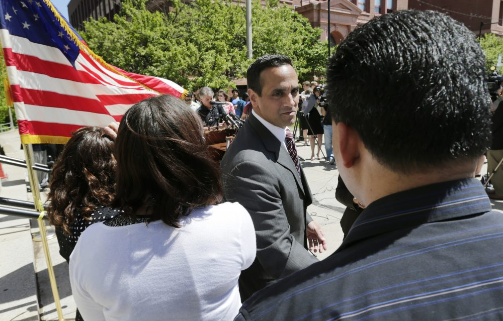 Somerville Mayor Joseph Curtatone shakes hands with residents following a 2014 news conference regarding immigration. (Charles Krupa/AP)
